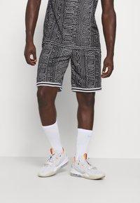 Nike Performance - DNA SHORT CITY EXPLORATION SERIES - Sports shorts - black/white - 0