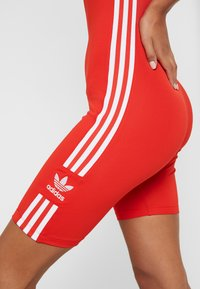 adidas Originals - CYCLING - Jumpsuit - lush red/white - 6