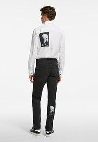 KARL LAGERFELD - Slim fit jeans - black - 2