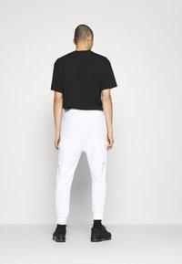Nike Sportswear - PANT - Tracksuit bottoms - white - 2