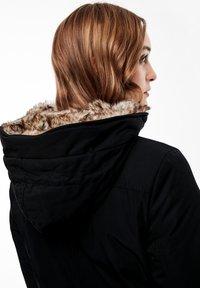 s.Oliver - MIT PLÜSCH-DETAILS - Winter coat - black - 5