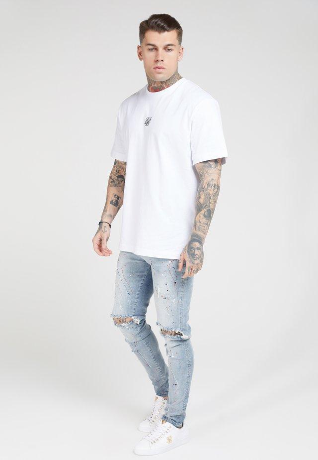 BUST KNEE RIOT - Jeans Skinny - light blue