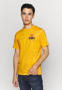 Diesel - T-JUST-N41 T-SHIRT - Print T-shirt - yellow - 0