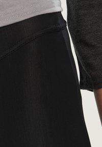 ODLO - BREEZE - 3/4 sportovní kalhoty - black - 3