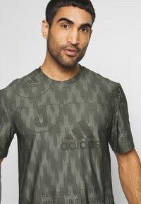 adidas Performance - CITY TEE - T-shirts med print - green - 3