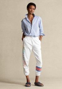 Polo Ralph Lauren - SEASONAL - Tracksuit bottoms - white - 1