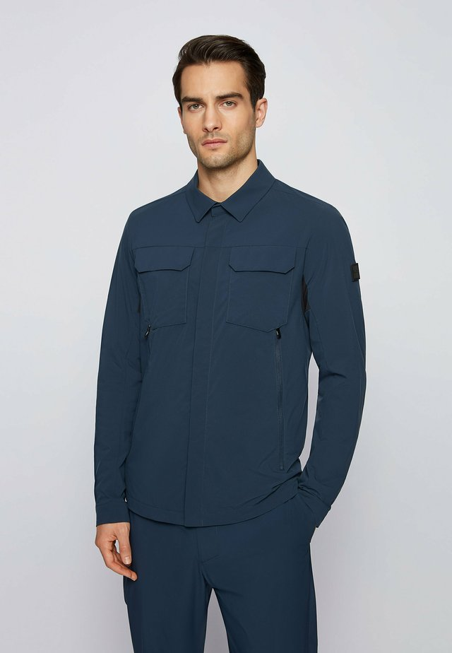 JADE - Waterproof jacket - dark blue