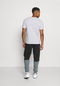 adidas Originals - SLICE - Tracksuit bottoms - black/blue oxide - 2