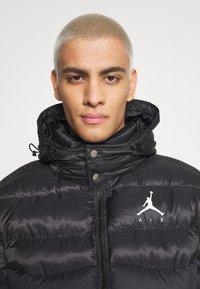 Jordan - JUMPMAN AIR PUFFER - Winter jacket - black/white - 4