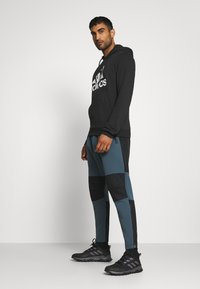 adidas Performance - ESSENTIALS SPORTS INSPIRED HOODED - Sweat à capuche - black - 1
