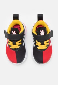 adidas Performance - FORTARUN MICKEY UNISEX - Neutral running shoes - core black/footwear white/vivid red - 3