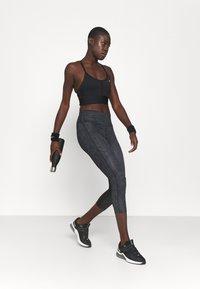 Nike Performance - INDY BRA - Sujetadores deportivos con sujeción ligera - black/white - 1