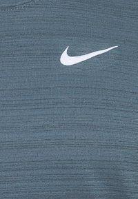 Nike Performance - MILER TANK - Sports shirt - ozone blue - 2