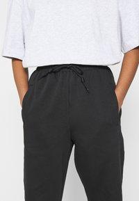adidas Originals - PANT - Tracksuit bottoms - black - 4
