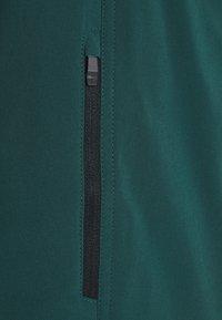 Ziener - NIW MAN SHORTS - kurze Sporthose - spruce green - 2