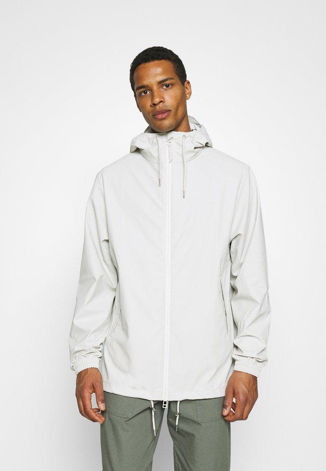 STORM BREAKER UNISEX - Waterproof jacket - offwhite