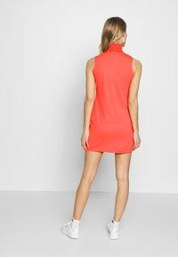 J.LINDEBERG - ELSA SET - Žerzejové šaty - tomato red - 2