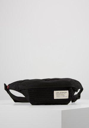 STANDARD BANANA SLING BATWING - Bum bag - regular black