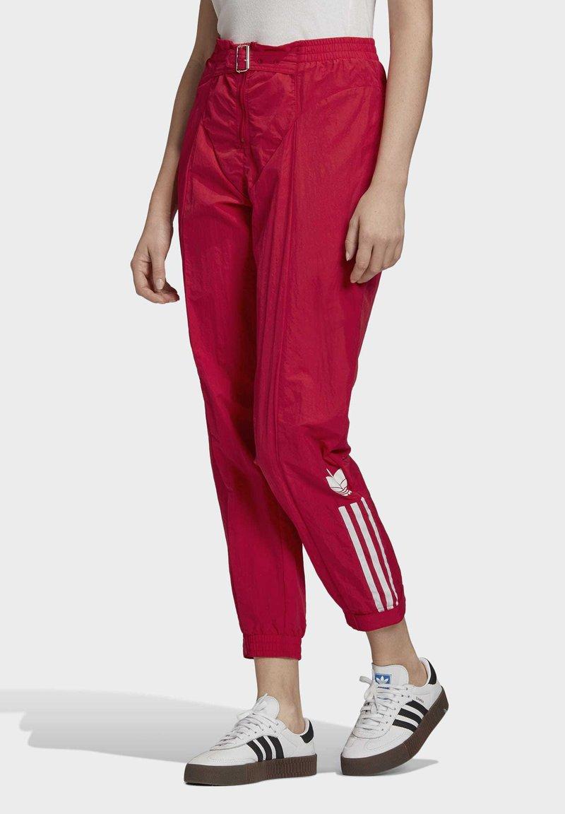 adidas Originals - PAOLINA RUSSO - Pantalon de survêtement - scarlet
