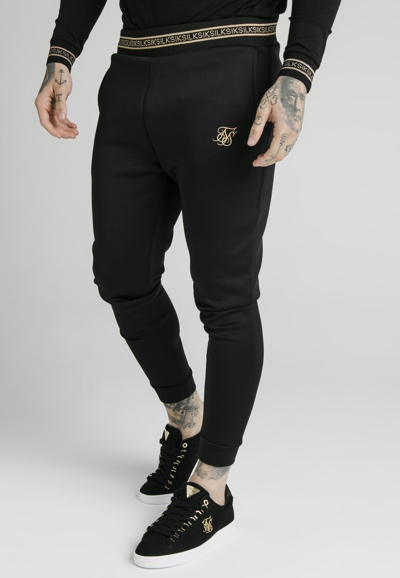 SIKSILK - ELEMENT MUSCLE FIT CUFF JOGGERS - Tracksuit bottoms - black/gold