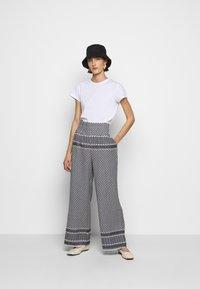 CECILIE copenhagen - BASIC TROUSERS - Trousers - black/white - 1