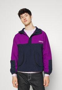 adidas Originals - WINDBREAKER - Tunn jacka - legend ink/glory purple - 0