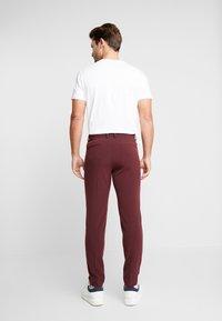 Lindbergh - CLUB PANTS - Trousers - red - 2