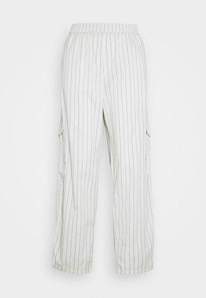 UNISEX SWEET LOOSE SURFER PANT - Cargo trousers - cream/black