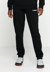 Hummel - HMLGO COTTON PANT - Tracksuit bottoms - black - 0