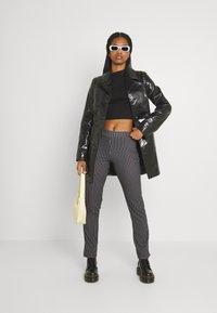 WAL G. - PIN STRIPE SKINNY TROUSERS - Trousers - black/white - 1
