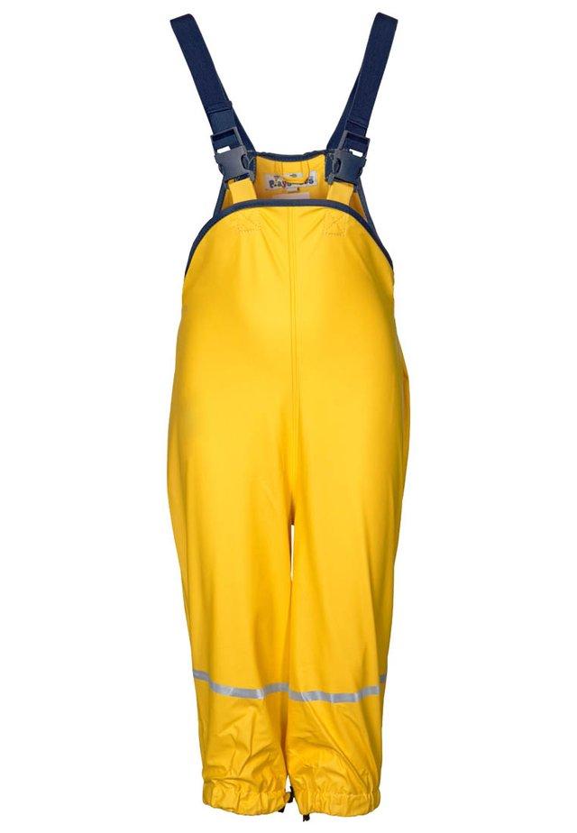 Pantalones impermeables - gelb