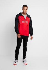 Nike Sportswear - Windbreakers - university red/black - 1