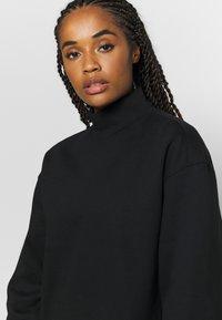 Filippa K - OVERSIZED BRUSHED  - Sweatshirt - black - 4
