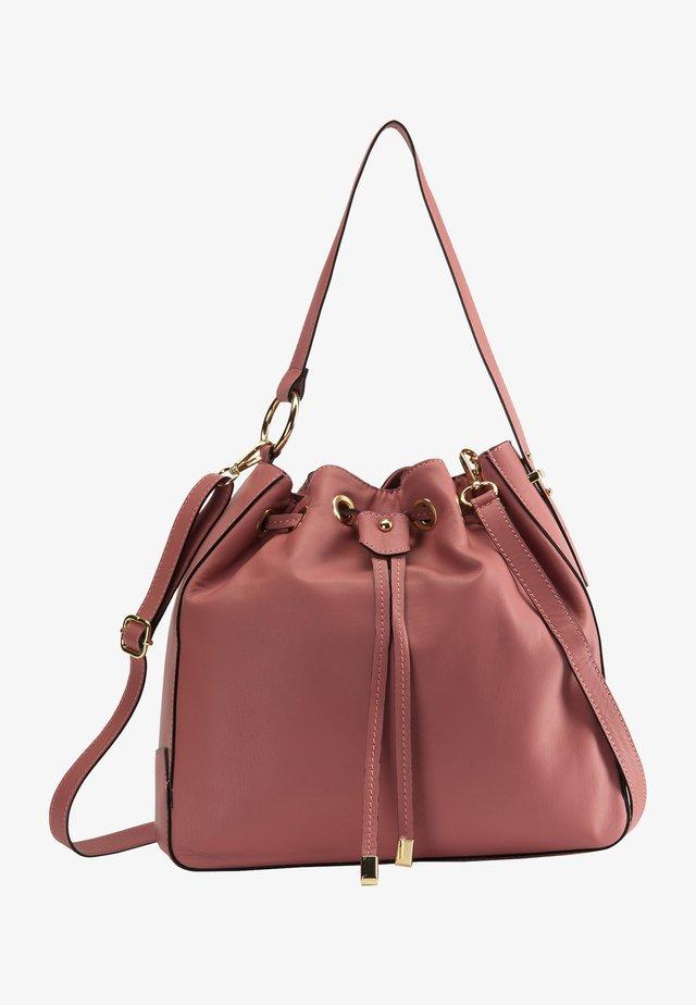 Käsilaukku - dunkelrosa