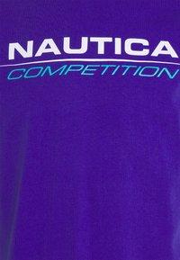 NAUTICA COMPETITION - VANG - Print T-shirt - purple - 2