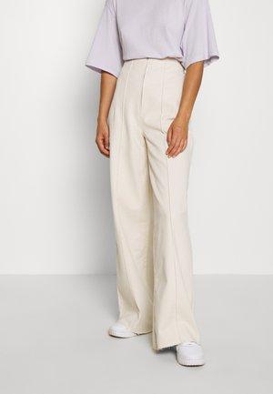 CORSET  - Flared jeans - ecru