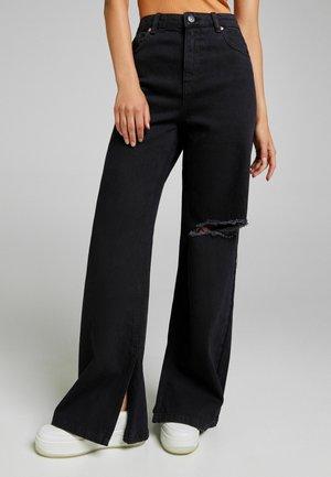 Široké džíny - black