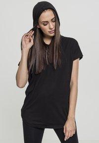 Urban Classics - LADIES SLEEVELESS HOODY - Print T-shirt - black - 0