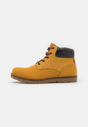 JAXED - Lace-up ankle boots - medium yellow