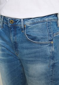 G-Star - ARC 3D LOW BOYFRIEND - Jeans Tapered Fit - azure stretch denim authentic faded blue - 3