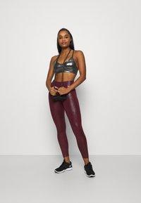 Nike Performance - Leggings - dark beetroot - 1