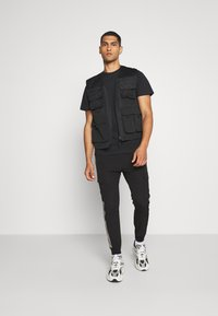 HUF - JUNGLE CAT TEE - Print T-shirt - black - 1
