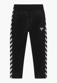 Hummel - KICK - Tracksuit bottoms - black - 0