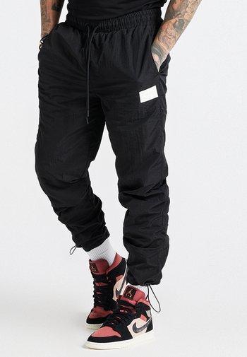 AOKI TOGGLE CUFF PANT - Träningsbyxor - black