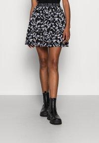 Calvin Klein Jeans - LOGO WAISTBANDSKIRT - Mini skirt - black floral aop - 0