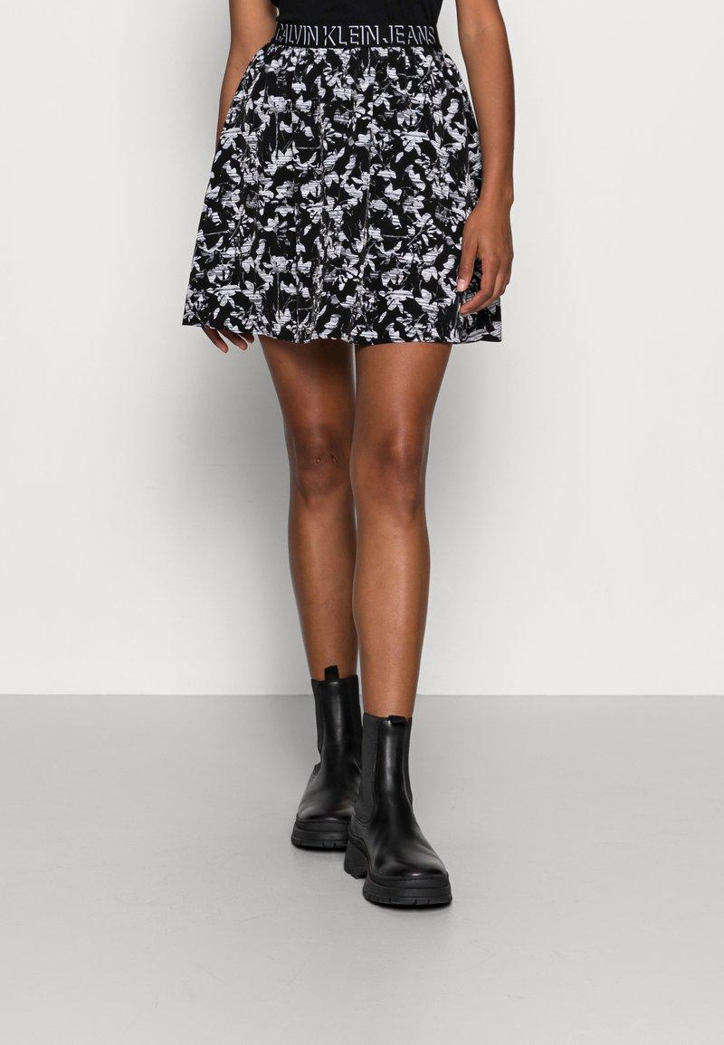 Calvin Klein Jeans - LOGO WAISTBANDSKIRT - Mini skirt - black floral aop