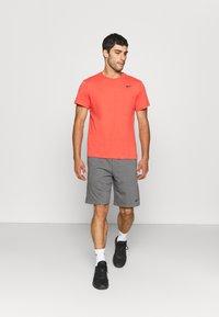 Nike Performance - TEE CREW SOLID - Basic T-shirt - lobster/black - 1