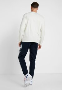 Champion - CUFF PANTS - Pantalones deportivos - dark blue - 2