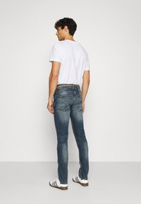 TOM TAILOR DENIM - PIERS DESTROYED - Slim fit jeans - mid stone wash - 2