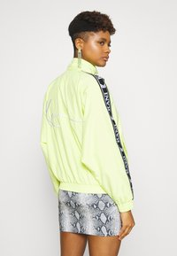 Karl Kani - OG TAPE TRACK JACKET - Training jacket - yellow - 2